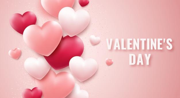 バレンタインデーの背景に赤とピンクのハート、紙吹雪