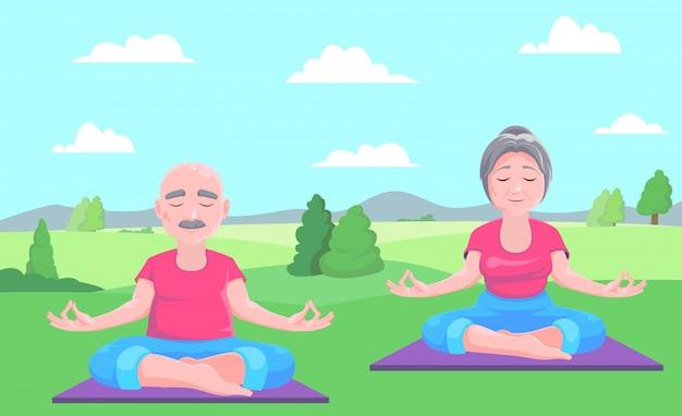年配の男性と女性がカーペットの上に座って瞑想します。