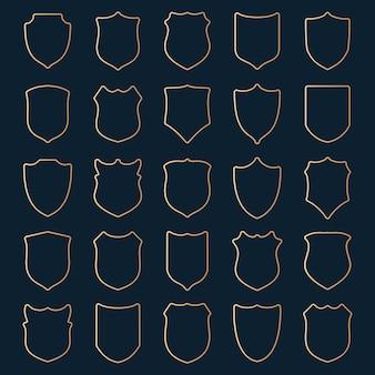 Большой набор золотых контурных щитов на синем