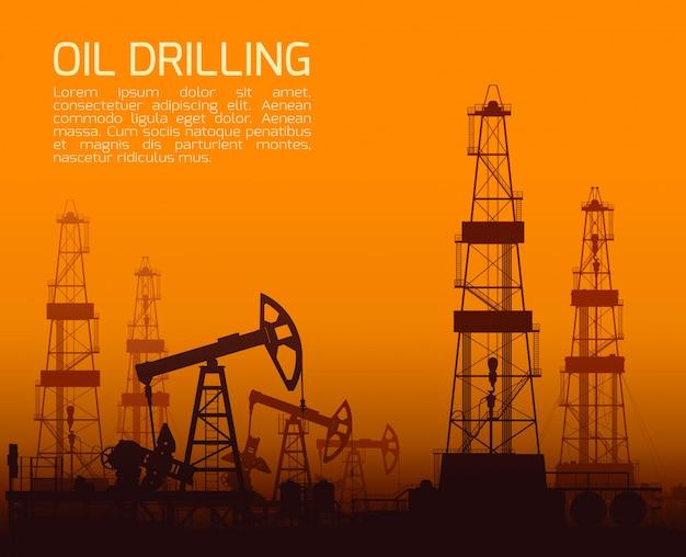 日没時の掘削リグと油ポンプ