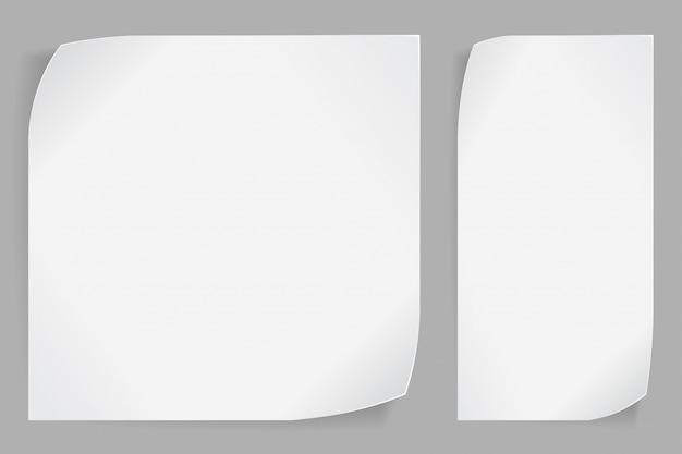 Белые бумажные наклейки на сером фоне