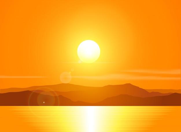 山脈に沈む夕日を風景します。