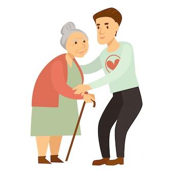 親切な男性ボランティアが杖で老婦人を助けます