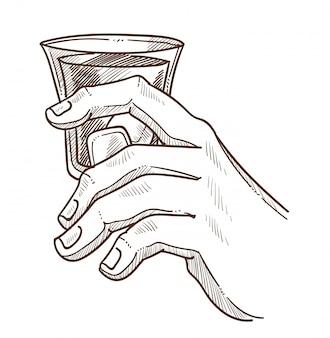 ウイスキーのグラスを手に持つ