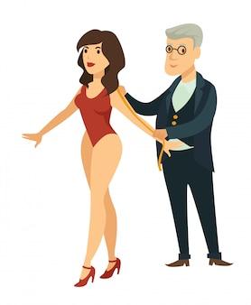 スーツのベテランデザイナーはモデル図の測定をします