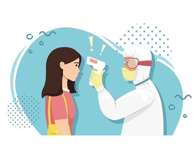 細菌保護の人は、サーマルイメージャーで少女の体温を測定します。ウイルス性疾患。流行。