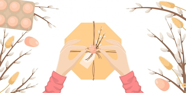 Иллюстрация пасхи с пасхальными яйцами и ветвями вербы. руки девушки открывают подарок.
