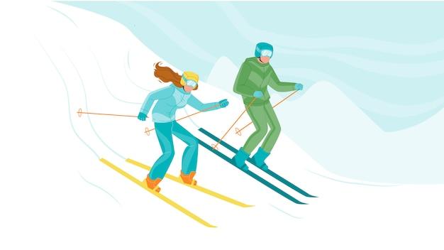 男と女が丘から下り坂でスキー