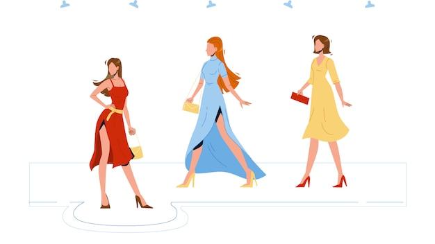 モデルの女の子が表彰台にファッションアパレルを着る