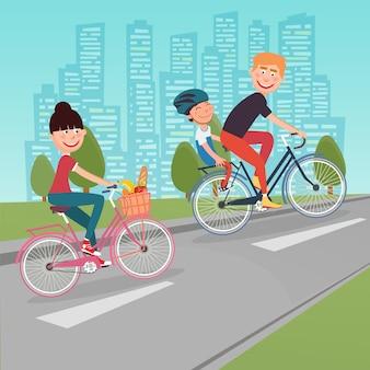 市内の幸せな家族の乗馬バイク。自転車の女性。父と息子。