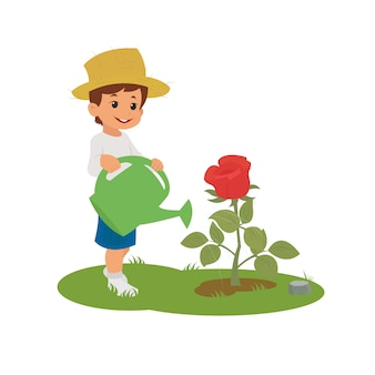 Мальчик поливает цветок.