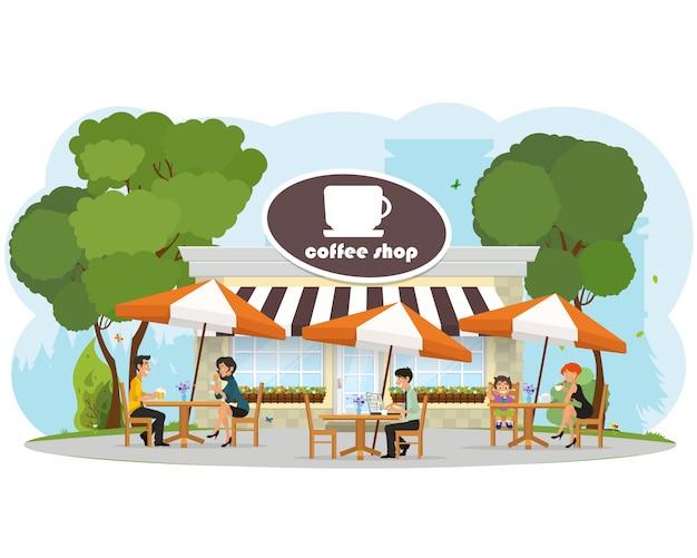 都市公園のカフェでリラックスしたさまざまな人々。