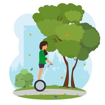 Девушка в городском парке едет на сегвее.