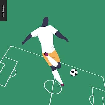 ヨーロッパのサッカー、サッカーボールを蹴るヨーロッパのサッカー用品を身に着けているサッカー選手