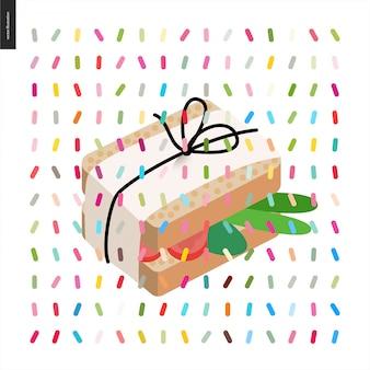パックスレッドと紙で包まれたサンドイッチ