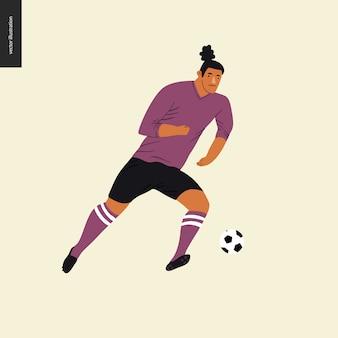 欧州サッカー、サッカーボールを蹴るサッカー選手