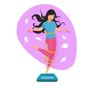 スリムな美しい女の子、体重計と笑顔でジャンプ