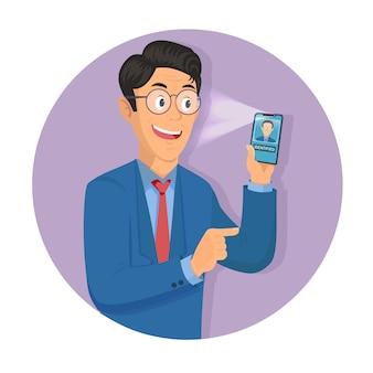 男は顔認識技術を介してデバイスにアクセスするための彼の手にスマートフォンを保持しています。