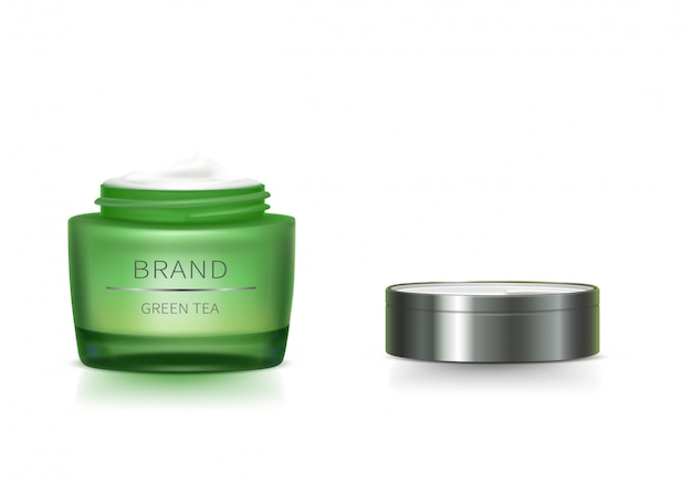 開いたふたが付いている緑のガラス瓶