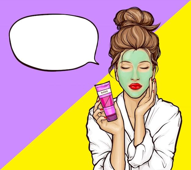 顔に化粧品のマスクを持つポップアートの女の子