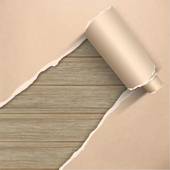 木の板の壁に引き裂かれた古いグランジ羊皮紙クラフト紙。