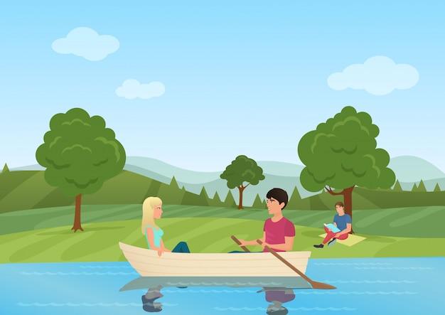 Пара купается в лодке в пруду в парке