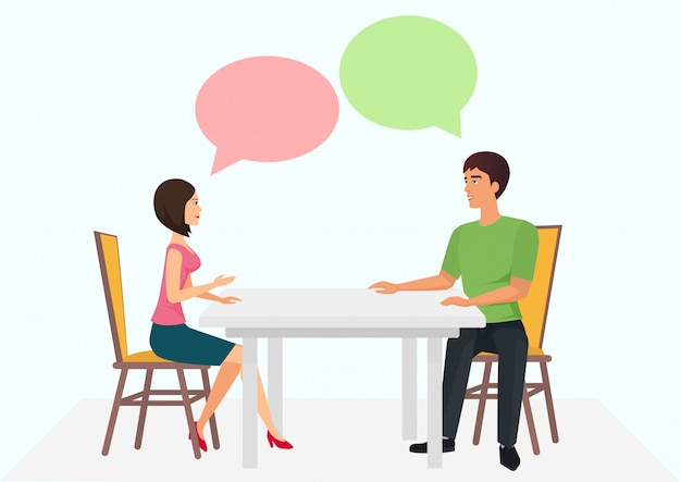Молодой мужчина и женщина сидят за столом и разговаривают. мужской женский разговор диалоги.