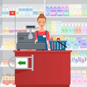 Продавщица женщина кассир, стоя на кассе в супермаркете.