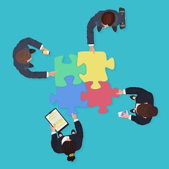 ジグソーパズルのピースを持つ事業チーム