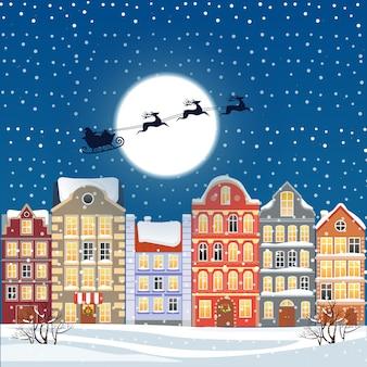 Санта летит по ночному небу под старым городом
