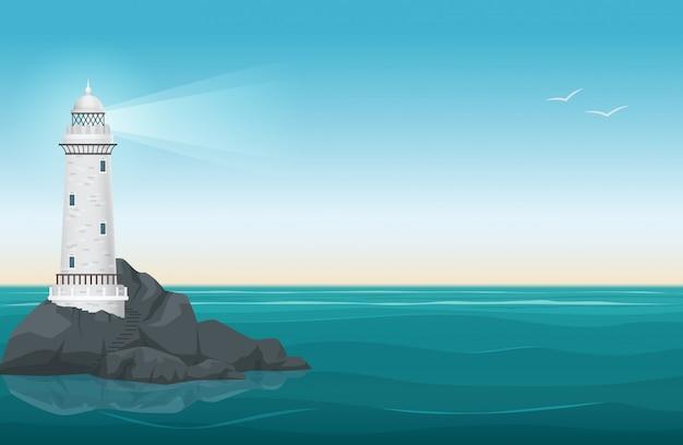 岩の島の風景の上の灯台
