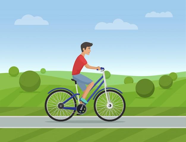 Молодой человек, езда на спортивном велосипеде