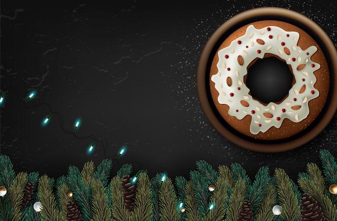 フルーツと木製のテーブル、トップビューでナッツのクリスマスケーキ。