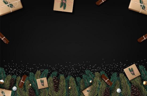 黒の背景にクリスマスツリーの枝、