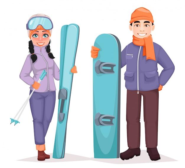 Мужской сноубордист и лыжница