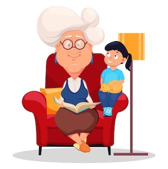 Бабушка сидит в кресле с внучкой