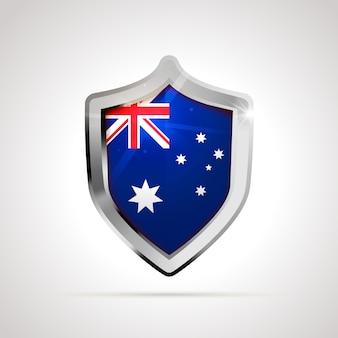 光沢のある盾として投影されたオーストラリアの旗