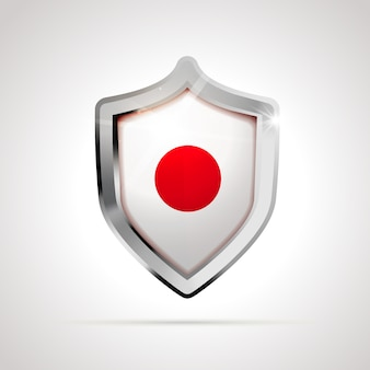 光沢のある盾として投影された日本の国旗