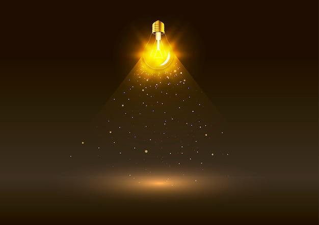 暗闇の中で黄金の光と明るい電球