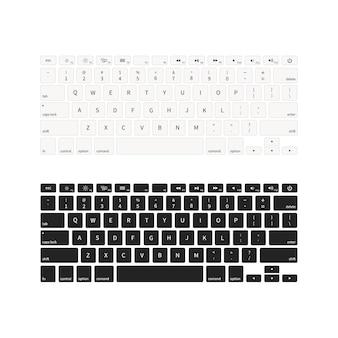白で隔離される異なる色のノートパソコンのキーボード