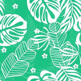青い熱帯の葉のパターン。モンステラ、バナナ、ヤシの木の白い葉と熱帯のシームレスパターン