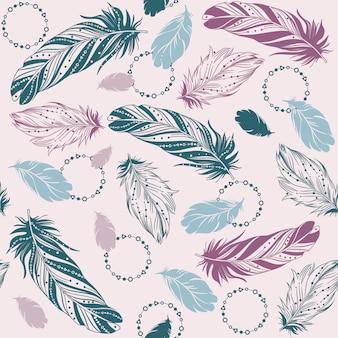 鳥の羽とのシームレスなパターン。手描きイラスト。エスニックデザイン