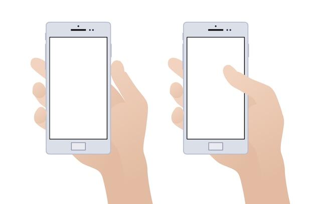 空白の画面を持つスマートフォンを持っている手