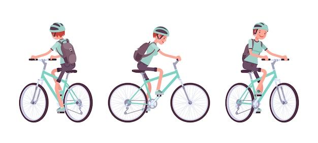 Молодая женщина катается на спортивном велосипеде