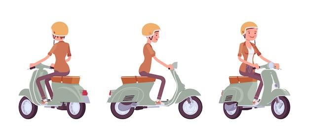 スクーターに乗って若い女性