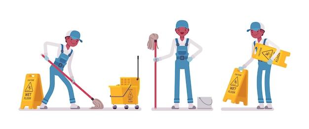 Мужской уборщик моет пол