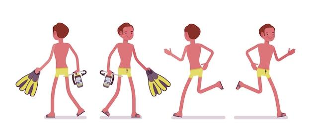 マスクと足ひれセットを持つ若い男を歩くと実行