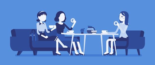 Девушки сидят в кафе у баннера
