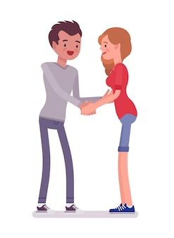 両方の手で若い男と女のハンドシェーク