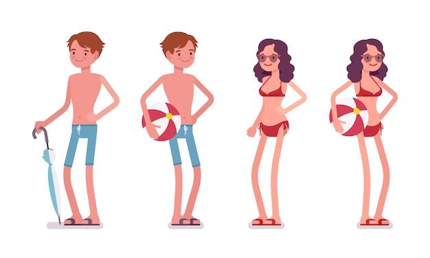 Мужчина и женщина в наборе пляжной одежды, стоя и отдыха